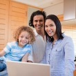 Cheerful family surfing the internet in the kitchen together — Stock Photo #11209854