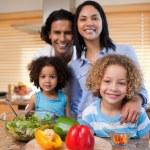 Family preparing salad together — Stock Photo