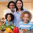 Family with salad together in the kitchen - Foto de Stock