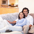 Cheerful couple on the couch together — Stock Photo