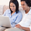 Couple booking holidays online together — Stock Photo