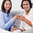 Couple drinking sparkling wine on the couch — Stock Photo