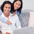 Couple shopping online together — Stock Photo