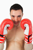Confident looking boxer behind cover — Stock Photo
