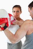 Young woman with her martial arts trainer — Foto Stock