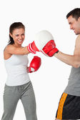Aggressive female boxer striking her target — Stock Photo