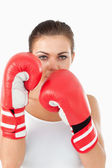 Female boxer behind cover — Stock Photo