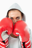 Female boxer with hoodie on in defensive stance — Stock Photo