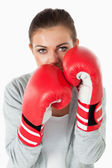 Portrait of a woman with boxing gloves — Stock Photo