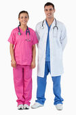 Portrait of a doctor and a nurse standing up — Stock Photo