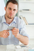 Businessman has to get rid of his credit card — Stock Photo