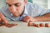 Businessman counting coins — Stock Photo