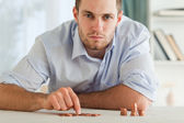 Desperate businessman counting his small coins — Stock Photo