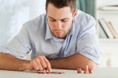 Businessman counting his small change — Stock Photo