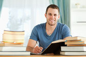 Smiling student preparing for exam — Stock Photo