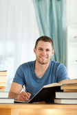 Student reviewing his subject material — Stock Photo