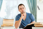 Student sitting at his desk doing his homework — Stock Photo