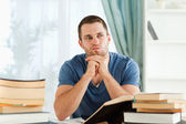 Student sitting at his desk in thoughts — Stock Photo