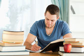 Student working through his books — Stock Photo