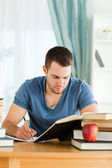 Student working through subject materials — Stock Photo