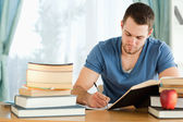 Student focused on his homework — Stock Photo