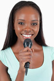 Close up of happy smiling female singer — Stock Photo
