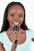 Close up of brightly smiling female singer — Stock Photo