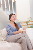 Portrait of a young woman watching TV — Stock Photo