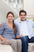 Portrait of a couple sitting on a sofa — Stock Photo