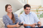 Smiling couple playing video games — Stock Photo