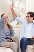 Portrait of a cheerful couple playing video games — Stock Photo