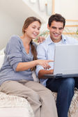 Portrait of a couple using a laptop — Stock Photo
