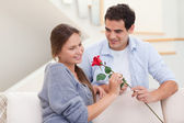 Man offering a rose to his fiance — Stock Photo