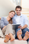 Portrait of a lovely couple using a tablet computer — Stock Photo