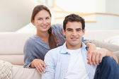 Couple sitting in their living room — Stock Photo