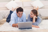 Smiling couple surfing on the internet — Stock Photo