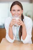 Portrait of a woman drinking milk — Stock Photo