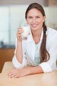 Portrait of a glowing woman drinking milk — Stock Photo