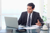 Upset businessman during a video conference — Stock Photo