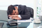 Tired businessman sleeping — Stock Photo