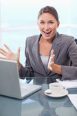 Portrait of a surprised businesswoman working with a notebook — Stock Photo