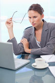 Portrait of a businesswoman using a laptop — Stock Photo