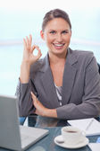 Portrait of a businesswoman signing that everything is okay — Stock Photo