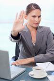Portrait of a businesswoman refusing a conversation — Stock Photo