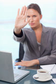 Portrait of a young businesswoman refusing a conversation — Stock Photo