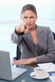 Portrait of a young businesswoman pointing at the viewer — Stock Photo