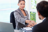 Businesswoman shaking hands with customer — Stock Photo