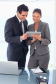 Trades partner looking at tablet in their hands — Stock Photo