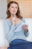 Woman thinking about her notes — Stock Photo