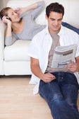 Couple enjoying their spare time in the living room — Photo